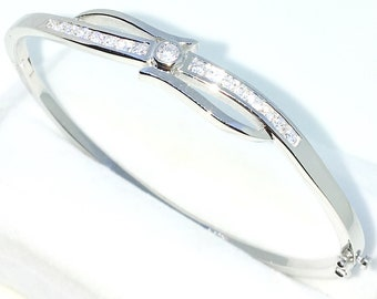 New White Gold Layered on 925 Solid Sterling Silver Oval Bangle Bracelets Single row of White round CZ and Box clasp