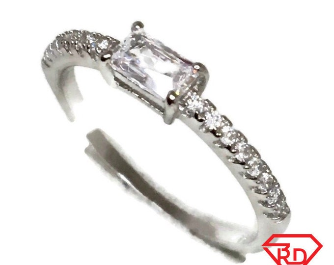 Brand New White Gold on 925 Sterling Silver thin Ring Band Emerald White CZ and small round white cz ( size 6 )