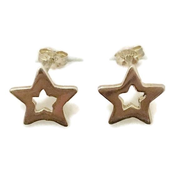 Brand New Anti-tarnish Silver Earrings small studs hollow star shape ( 12 . 0 mm )