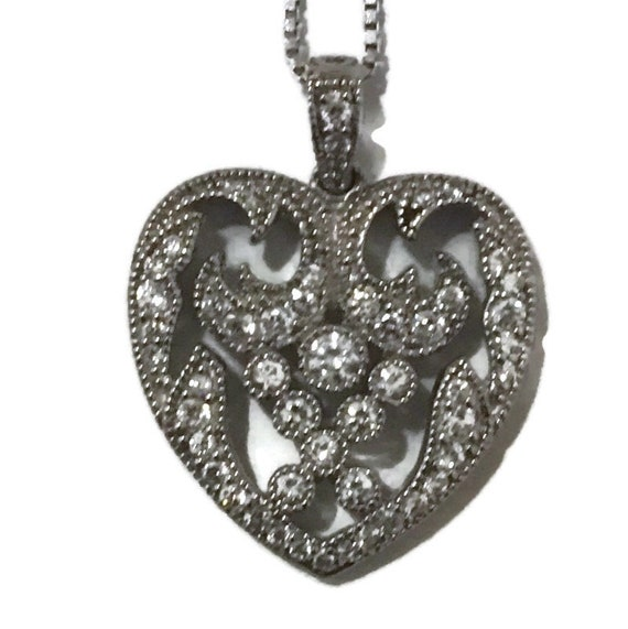 Brand New White Gold on 925 Sterling Silver Pendant heart shape with unique design and white round CZ with free chain ( 20 . 5 mm )