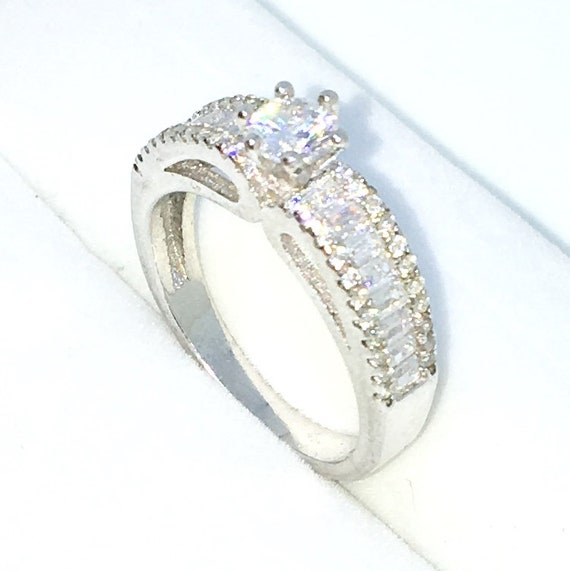 New Handcraft White Gold Plated on Sterling Silver ring band with row of white emerald CZ and single round white CZ