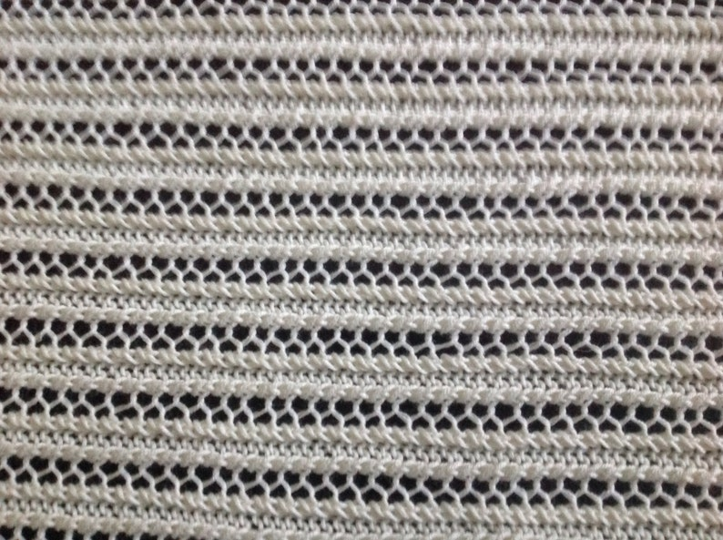 Nice and soft handknitted off white baby blanket
