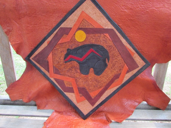 Wall Hanging:  Zuni Bear Fetish Within Disjointed Circles of Life Energized by the Sun