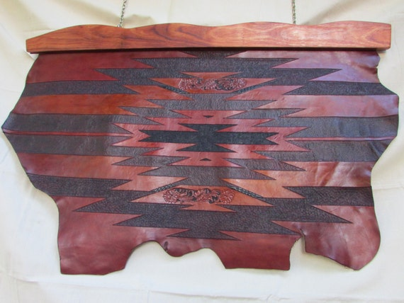"One-of-a-kind 30"" X 48"" Carved leather wall hanging w/ bubinga wood hanger."