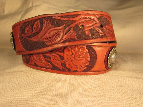 "1.75"" hand tooled leather belt with Rose Pattern and two conchos."