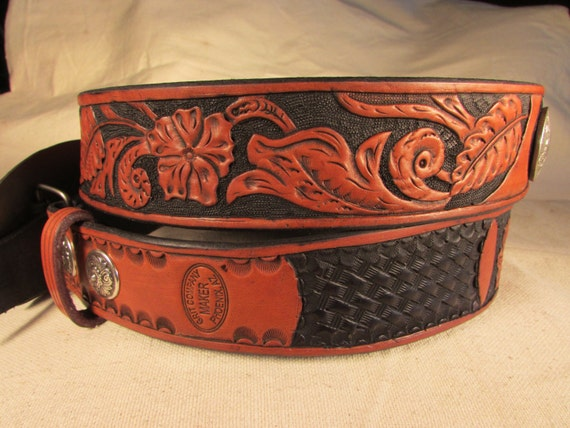 "1.75"" hand tooled leather belt with Wild Flower / Basket-weave pattern and two conchos."