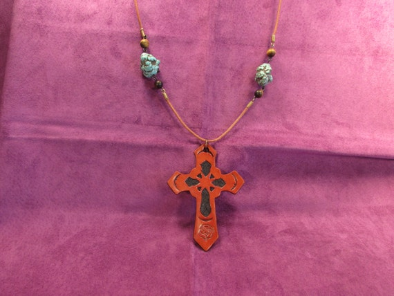 Hand Tooled Leather Rose-Cross Pendant with Two Turquoise (Rough Nugget) Stones between Tiger Eye Beads on Bown Leather Cord Necklace
