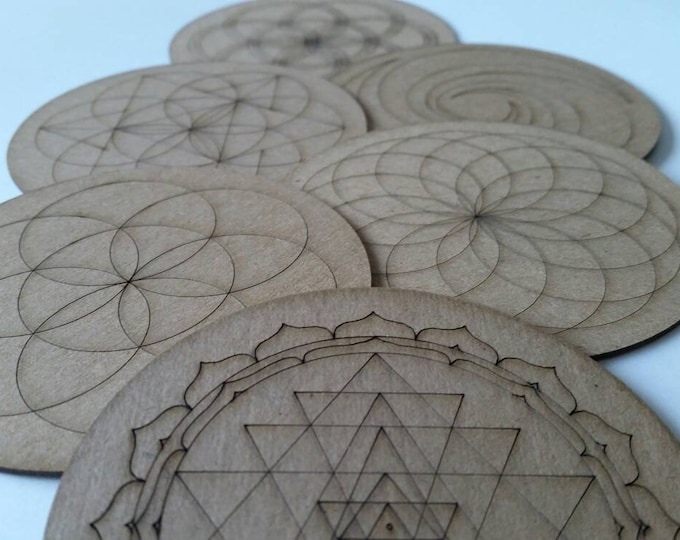 Upcycled chipboard coasters, sacred geometry designs, crystal gridding boards