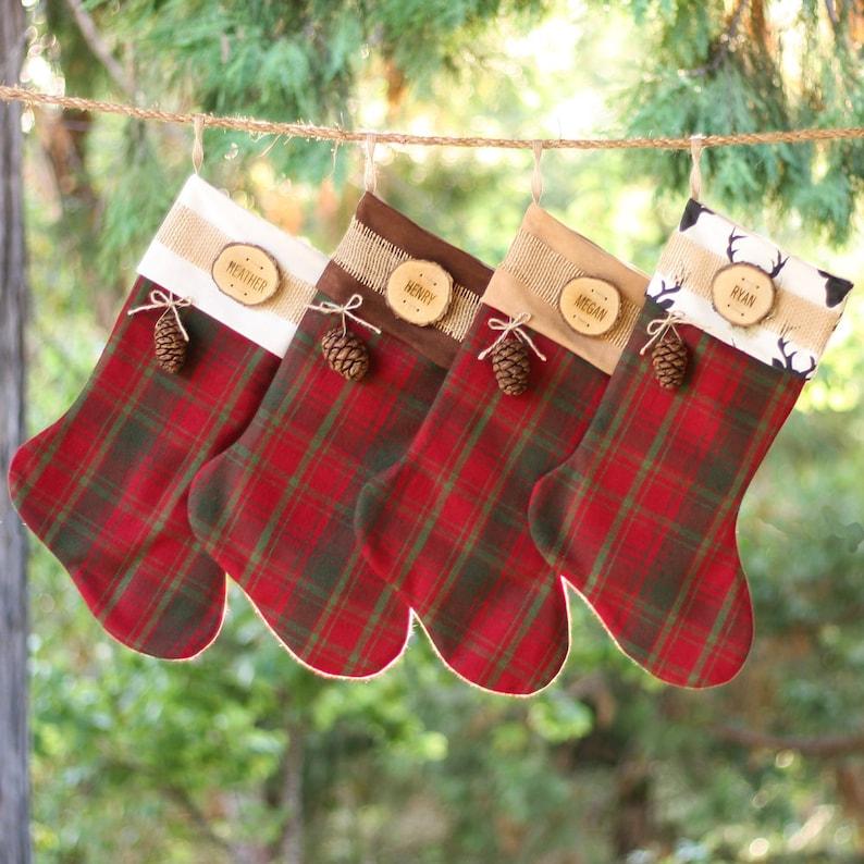 Holiday Stockings Christmas with Wood Slice Name Tag and Redwood Cone Rustic Woodland Christmas Plaid