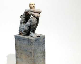 Man Looking At Object On Pedestal Univerthabitat