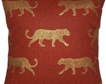 Leopard print cushion cover - metallic gold leopards on a terracotta - burnt orange - background - STUNNING!