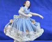Miniature lace figurine vintage collectable of a ballerina dancer manufactured by the Dresden porcelain factory in the early 1950s