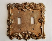 Ornate Switch Plate Double Toggle Light Switch Cover Brass Gold Tone Ornate Roses and Swirls 1967 American Tack Hardware Co