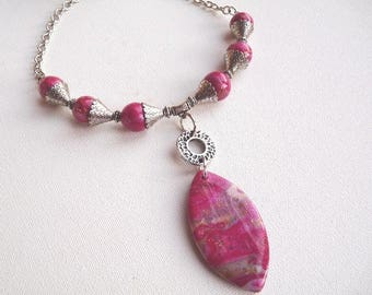 Gold Fuchsia beaded necklace and large oval Center bead