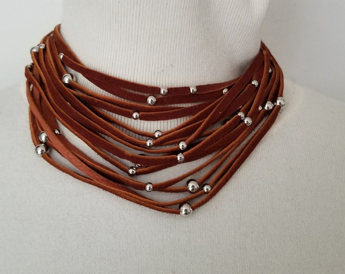 Multi Strand Leather  Necklace with Stainless Steel beads.