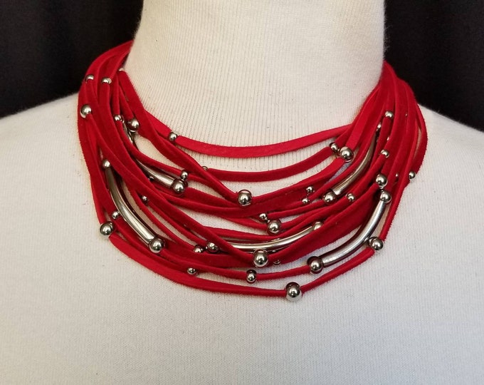 Multi Strand Red Leather necklace with stainless steel bars and beads.