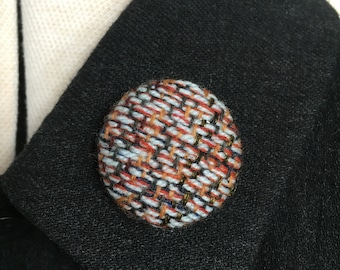Handwoven fabric covered brooch   pin badge