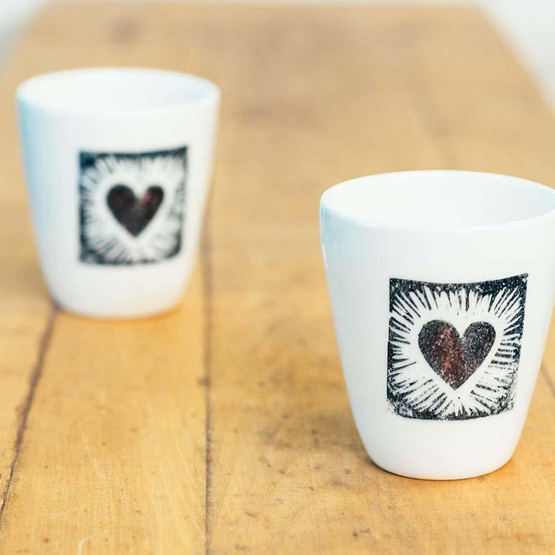 Framed heart ceramic cup is a simple modern tumbler for water image 0