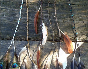Feather hair/Dreadschmuck with pebbles, bells brass pendants and feathers