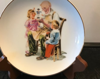 Norman Rockwell inspired Decorator Plate, The Toy Maker Museum Collections Inc, 1986.