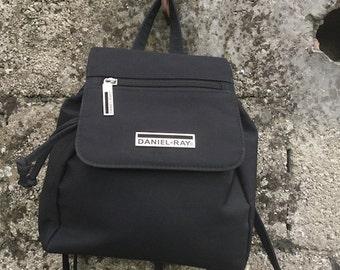 Backpack Vintage  90s  Black  Nylon  adjustable straps  three pockets   Lined  internal zip  height 23 cm 7d52b664f2