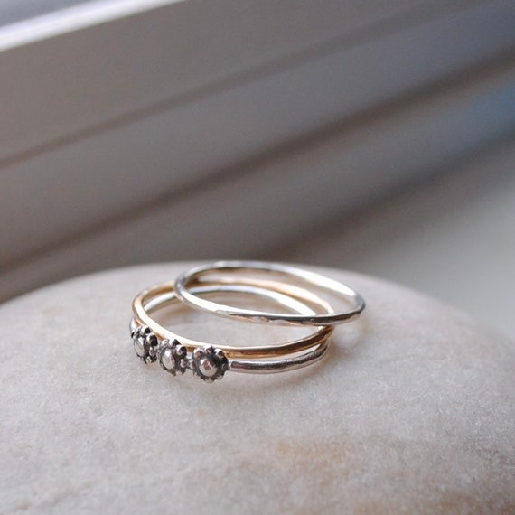 Sterling Silver & 14k Gold Hand Hammered Rings paired with a Sterling Silver Daisy Ring