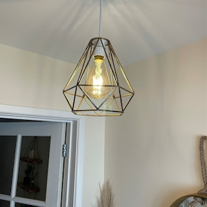 Anna reviewed Vintage Industrial Retro Suspended 3 Head Ceiling Pendant Light Lampshade Light