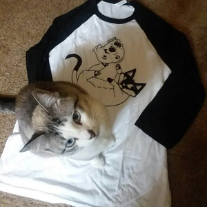 Cammie Kay Tee-Schmidt added a photo of their purchase