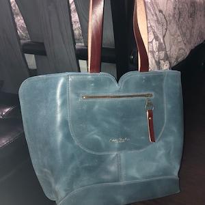 Lysliana Curbelo added a photo of their purchase