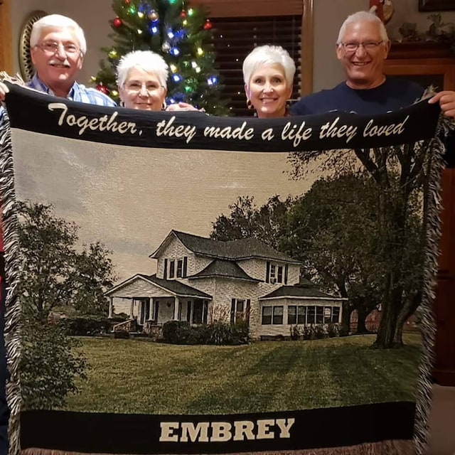 family with photo blanket