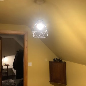 Andrea reviewed Vintage Industrial Retro Suspended 3 Head Ceiling Pendant Light Lampshade Light