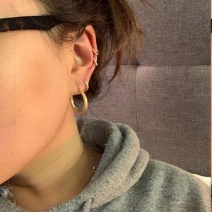 Dainty Huggie Hoop Earrings • rounded hoop earrings • cartilage hoop • gold conch hoop • small helix hoop • huggie earrings • tragus hoop photo