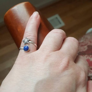 Sheila Ocoma added a photo of their purchase