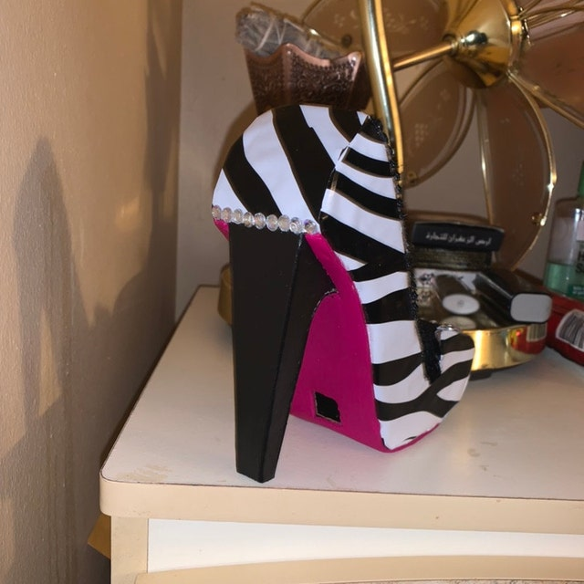 Malikah Amatullah added a photo of their purchase