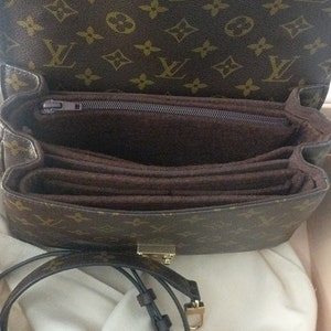 Helen Ortanez added a photo of their purchase