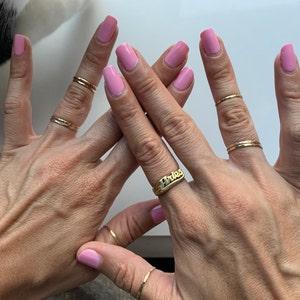 Liz Belfer added a photo of their purchase