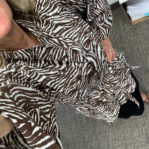 Betty Simonetti added a photo of their purchase