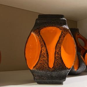 in a \u201cScrezioto Tabacco\u201d glaze A Stunning and Iconic Mid-Century Italian Bertoncello vase and as designed by  Roberto Rigon