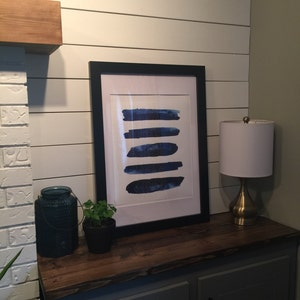 Sarah Dickenson added a photo of their purchase