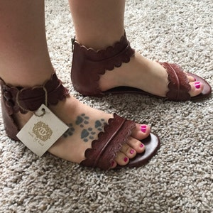 Sally Giannini added a photo of their purchase