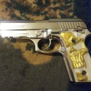 Taurus PT92, PT99, PT101 pistol grips gold skull on pearl for decocker
