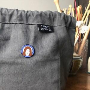 Robyn Fenton added a photo of their purchase
