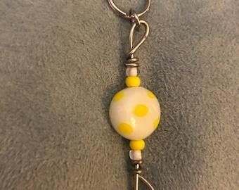 Yellow polka dot zipper pull