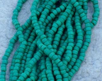 Green glass crow beads , 9 mm opaque