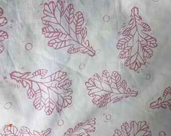 Hand printed pink teatowel in oak leaf design