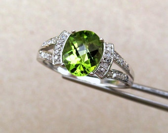 Elegant Genuine Peridot Checkerboard Oval in Sterling Accented Ring