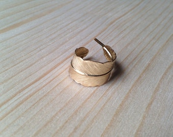 Adjustable raw brass feather ring