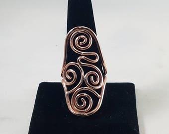 Copper swirl saddle ring