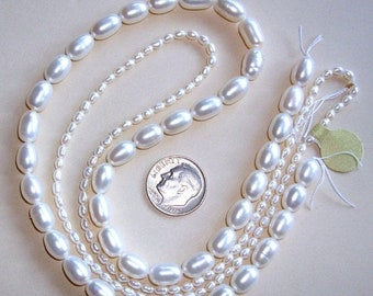 ON SALE 2 Strands of WHITE Oval Fresh Water Pearls - 2 Different Sizes