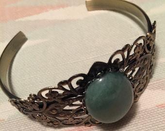 Jade crystal on bracelet